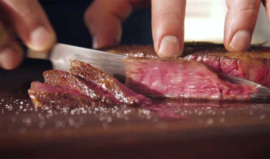 Slicing through a sous vide steak