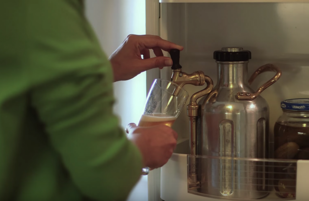 Pouring a beer from a fridge using a uKeg