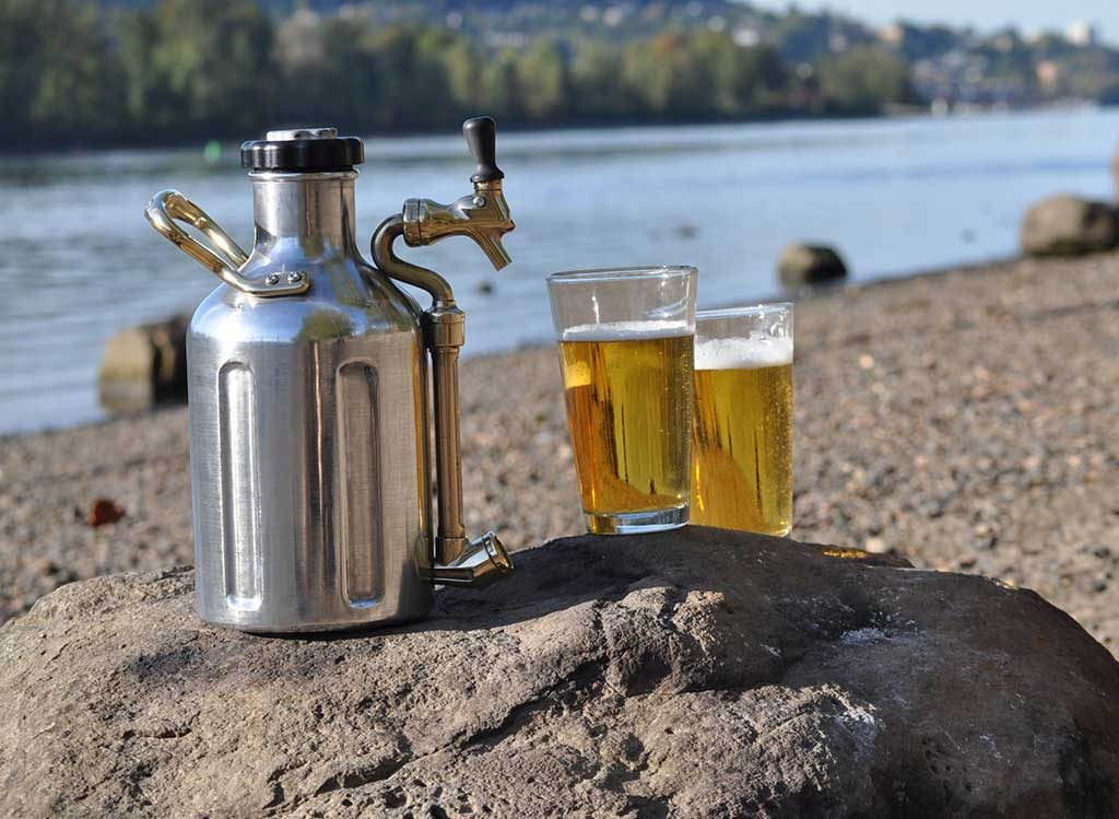 Stainless Steel uKeg on a beach with 2 pints